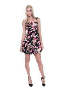 73e99cdf06fb4 $35.00 This skater dress features a bold floral print, sweetheart neckline,  sleeveless, and an elastic back details.