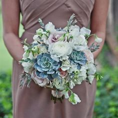 love this bouquet with the succulents, but with light corals and pinks and yellow flowers