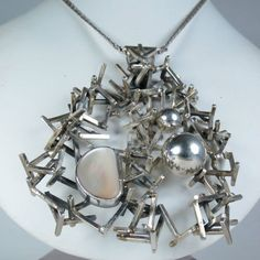 Amazing modernist Rachel Gera silver and mother-of-pearl pendant
