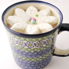 Blooming marshmallow, recipe with bagged marshmallows, white chocolate, powdered sugar and flower centers.