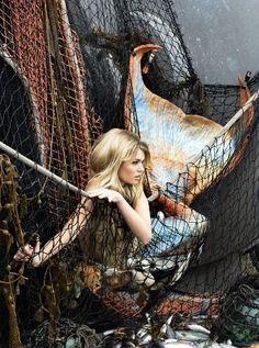 Mermaid in a fishing net.