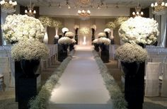 Aisle Inspiration - for just inside sanctuary doors (or all the way through, depending on cost) - baby's breath and hydrangea