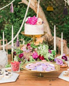 You'll Want to Pin Every Detail of This Boho-Chic Bachelorette Party | Martha Stewart Weddings - The standout element of the day? The food and drink display. Since the bride loves her sweets, the table was teeming with desserts. Twink + Sis custom-made the tassels and collaborated with Iris & Daughter for the rope, which served as a beautiful backdrop and was also woven through the buffet items.