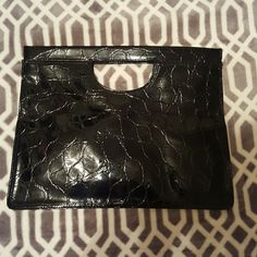 FREE WITH PURCHASE OF $25 OR MORE Oversized black clutch in perfect condition, perfect for makeup, accessories or as an overnight bag, even fits a laptop! Must spend  $25 in my closet to qualify - find one item at $25 or more, or bundle a few items! My discount is 20%! Bags