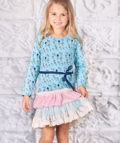 With a darling ruffled drop-waist skirt, ribbon sash and sweet floral print, this dress is ready for a walk on the smile side. A pullover design and long sleeves keep cuties comfy with delightful ease.100% knit cottonMachine wash; tumble dryImported