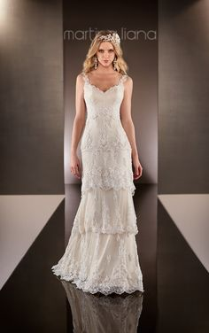 This Parisian Silk Chiffon sheath wedding dress from the Martina Liana designer bridal gowns collection features an overlay of layered scalloped Lace down to a sweep train.