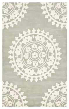 """Handmade Soho Chrono Grey/Ivory New Zealand Wool Rug  Price: $399.99   Visit Store »  Uploaded by Daniela Shuffler  I really love the medallions on this rug, and the gray hue could work to anchor a nursery and elevate it to make it feel less baby and more plush. This is a rug that is sure to stick around once the room is no longer a nursery.    Dimensions: 7'6"""" x 9'6"""""""