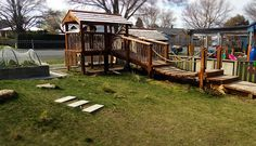 Fort in playground. A walkway leads from two areas of the playground to this fort. Children can watch the activity on the road in this rural town.
