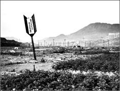 A large implanted arrow marks Ground Zero a few months after where the plutonium implosion-type Atomic Bomb Fat Man struck at Nagasaki, Japan, on August 9, 1945 after being dropped from the B-29 Bomber Bock's Car.