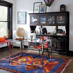 a clear modern desk against a traditional credenza nice mix for the home cb2 office