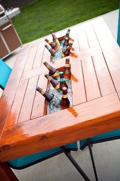 DIY Wood Patio Table w/Built in Beer/Wine Cooler. Would also be cute as a craft or office table, you could put supplies in the middle. A pretty dining table with flowers in the middle, etc.