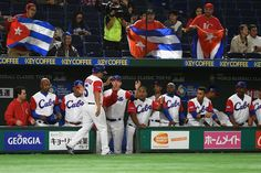 Infielder Carlos Benitez #5 of Cuba high fives with his team mates after scoring a run by a RBI single of Outfielder Yoelkis Cespedes #16 in the bottom of the fourth inning during the World Baseball Classic Pool B Game Two between China and Cuba at Tokyo Dome on March 8, 2017 in Tokyo, Japan.