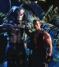 Kevin Peter Hall as the Predator with Arnold Schwarzenegger in a publicity still for #Predator (1987).
