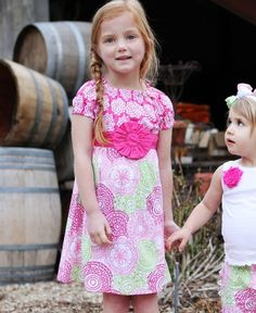 She is sure to soak in every sunny smile in this colorful and cheery cotton dress. Decorated with a feminine front flower, it slips on easily and looks effortlessly sweet during a girl's day out.