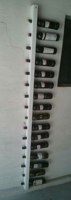 Wall wine rack for 16 bottles by VugecWoodworks on Etsy
