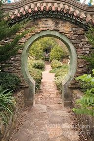 The Moon Gate frames a path that leads down to the lower pool and fountain at the Douglas Chandor Garden in Weatherford, Texas.