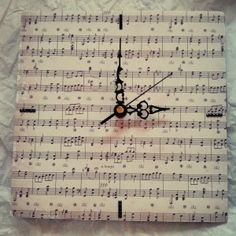 Great idea for above the piano....cover a canvas with vintage sheet music.