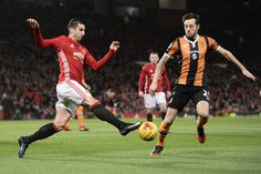 Manchester United's Armenian midfielder Henrikh Mkhitaryan (L) vies with Hull City's English midfielder Ryan Mason during the EFL (English Football League) Cup semi-final football match between Manchester United and Hull City at Old Trafford in Manchester, north west England on January 10, 2017.