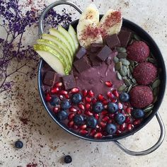"""Good morning! No better way to start the day than with a nutritious packed Acai and mixed berry bowl I used 1 large banana 1 cup of mixed frozen berries 3 tsp of Acai powder 1 tbs of chia seed and 1 tsp of baobab powder ( all  from @nutriseeduk ) 3/4 cup of almond milk. Blend until smooth and top with juicy pear more banana Pomegranate seeds blueberries pumpkin seeds chunks of """"lions raw"""" @consciouschocolate and homemade energy bliss balls ( recipe is way down my page somewhere so have a…"""