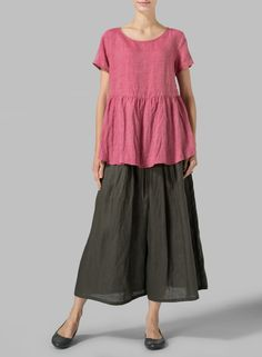 Linen Short Sleeve Pleated Blouse  Dress to impress in this beautiful breezy top fabricated from natural linen. Neatly pleated and flares out from the waist.