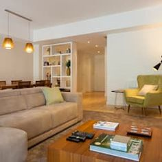 Salones de estilo moderno de Traço Magenta - Design de Interiores