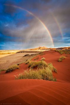 Namib Double Rainbow by Mark Dumbleton  Thursday, 8th November 2012    Heavy rain falls over the Namib Rand Conservancy in Namibia, illuminated by the late setting sun, creating a very striking double rainbow.