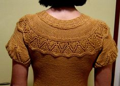 Designer suggests to keep yoke from sagging (in cotton), go down in needle sizes and make decreases at shoulders as approaching the neckline. Intriguing sleeves too!