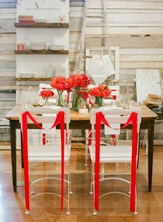 Fiesta red table decor. I love the simplicity of the bold draped ribbon on the back of the chairs. Credit.www.weddingomania.com #WedPin #AcademyLive #Wedding