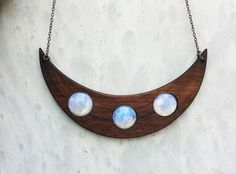 La Lune. Beautiful walnut crescent necklace with opalescent moons by Clever Kims Curios on Etsy. Gorgeous Goth witch magic fae oddities pagan jewelry