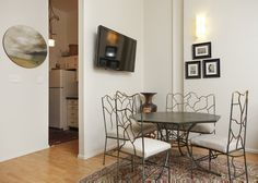 Beautiful dinette set and painting of the sky  Matilde & Gustavo's Arts District Apartment http://www.apartmenttherapy.com/matilde-gustavos-arts-district-apartment-house-tour-203452#gallery/47193/11