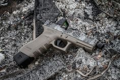 Glock 31. Frame Cerakoted Magpul FDE and outfitted with Lone Wolf internals. Complete Lone Wolf top end with Trijicon RMR adjustable LED cowitnessed with suppressor height sights. The slide was cerakoted black and the pattern was engraved over the finish.