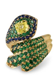 This hand-crafted jewelry creation features a coveted fancy yellow diamond at its center. Weighing 1.01 carats, the cushion-shaped gem is complemented by Tsavorite garnets and sapphires. Set in 18k yellow gold ~ haute joaillerie, designer jewelry, luxury, Cocktail Rings~ M.S. Rau Antiques