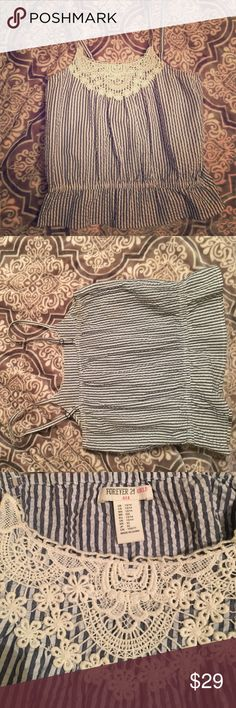 Forever 21 Striped Crochet Top Size for girls 13/14 years but fits like a small or x small top. Crochet detail on the chest, blue and white striped, with a cinched bottom. Super cute. Forever 21 Tops