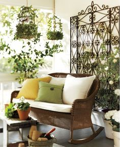 rocking love seat on summery porch