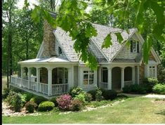 Love this Beautiful House!!! Bebe'!!! Love the Side Porch!!!