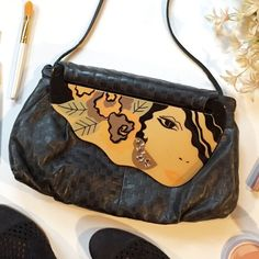 Moon Bags Patricia Smith Designs Artsy Black Purse This vintage purse is a rare and stunning addition to any closet. It is an art piece as much as it is a functional piece of fashion. Its base is made of carefully woven black leather and the top flap is a resin depiction of a woman. Made by a local Milwaukee artist its in gently used vintage condition. Other items for sale in cover shot include Franco Sarto Shoes. OFFERS AND BUNDLES WELCOME! Patricia Smith Designs Bags