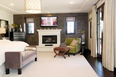master bedroom with cozy reading nook by fireplace