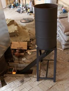 Burning Pellets in a Rocket Stove Mass Heater. Built Fall 2012 for use in a greenhouse. Diy Heater, Stove Heater, Pool Heater, Pellet Stove, Rocket Mass Heater, Rammed Earth Homes, Indoor Aquaponics, Outdoor Oven, Rocket Stoves
