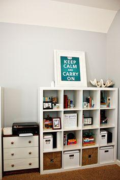 shelf display--I think I'll put baskets on the bottom like this--I like the tan straw type baskets