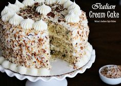 This spectacular Italian Cream Cake is a special cake for the most special of occasions. Toasted coconut ad pecans are sandwiched between layers of homemade cream cheese frosting.