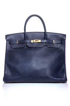 Hermès vintage tote, $12,759, matchesfashion.com.   - ELLE.com