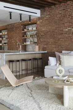A SoHo loft apartment with exposed brick walls and a neutral color palette with subtle color touches Exposed Brick Apartment, Exposed Brick Walls, Soho Loft, New York Loft, Berlin Apartment, Apartment Interior, Manhattan Loft, Loft Estilo Industrial, Industrial Loft Apartment