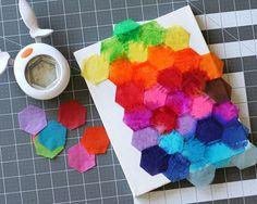 Fiskars Hexagon punch tissue paper on a canvas