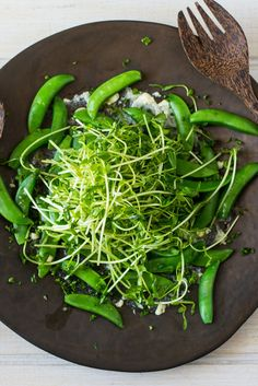 In this unusual salad, funky, creamy Camembert and crisp, juicy sugar snap peas unite to make a texturally complex and very flavorful dish. You can use any washed rind cheese here as long as it's ripe enough to be spread on a plate. If you can't find a gooey-centered cheese, you can substitute a creamy goat cheese instead. (Photo: Andrew Scrivani for The New York Times)