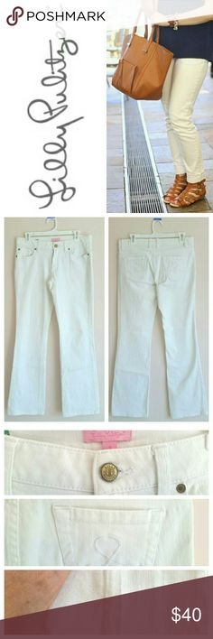 Lilly Pulitzer Palm Beach Straight White Jeans White jeans by Lilly Pulitzer in the popular Palm Beach Straight fit, sold out in stores and online. Classic 5 pocket design. Zip fly with signature button closure. Signature logo on rear pockets. Excellent condition. Only flaw is very slight dirt discoloration at very bottom hem of one pant leg (pictured). Only visible if you're really looking for it, since it's at ground level. No other flaws, stains, or tears. Bundle 2+ items and save 10%…