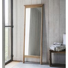 This wooden framed leaner mirror offers an elegant stylish design. The charming wooden frame offers a natural finish that will blend seamlessly into any interior. The natural finish to the wood will provide a bright airy feel to your interior that would certainly enhance your living space. This leaner mirrors tall