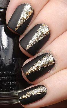 Elegant Black Matte Nails with Gold Embellishments on Top.