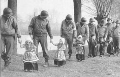 This photo is of post-war Europe with American GIs escorting war orphans.