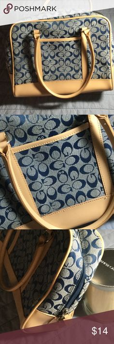 Navy and Tan Satchel Handbag GO 👜 handbag i. Navy and tan. Very roomy satchel with double handles no cute details. Outside pocket, plus inside zippered and open pockets. Measures 11.5 x 9 x 5 inches. Gently used...good condition. GO Bags Satchels