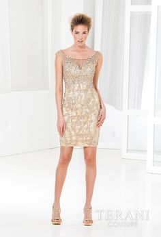 Fully embellished cocktail dress finished with a sweetheart and nude illusion neckline